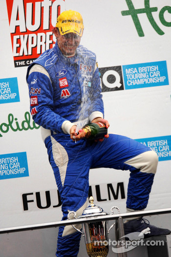 Tom Chilton sprays champagne