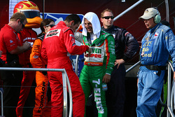 Danica Patrick, Helio Castroneves and Tony Kanaan share a moment