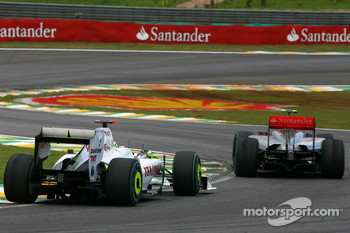 Jenson Button, Brawn GP and Heikki Kovalainen, McLaren Mercedes