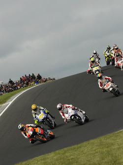 Start: Dani Pedrosa, Repsol Honda Team leads Casey Stoner, Ducati Marlboro Team and Valentino Rossi, Fiat Yamaha Team