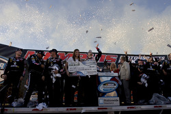 Victory lane: race winner Brad Keselowski celebrates