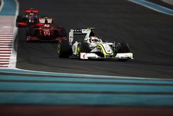 Rubens Barrichello, BrawnGP leads Kimi Raikkonen, Scuderia Ferrari
