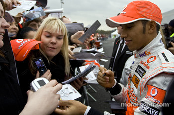Lewis Hamilton signs autographs for fans