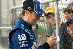 Kurt Busch, Penske Racing Dodge signs autographs