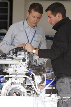Teams look at the Renault engine on display