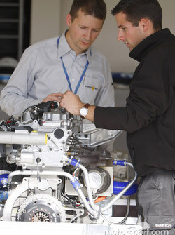 Teams look at the Renault engine on display