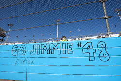 Fans write on the track wall before