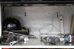 Tools sit in a pit box