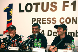 The newly-announced drivers for the Malaysian-backed Lotus F1 team: Jarno Trulli and Heikki Kovalainen share a light moment with team principal Tony Fernandes, during its announcement in Kuala Lumpur