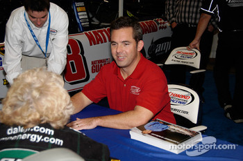 NASCAR star Hermie Sadler signs an autograph out on the show floor