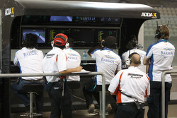 The Barwa Addax Team watch the action from the pit lane