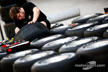 An engineer works on some Bridgestone tyre's