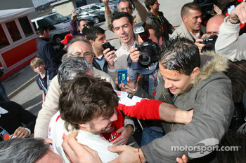 Fernando Alonso, Scuderia Ferrari pushes his way through the crowd