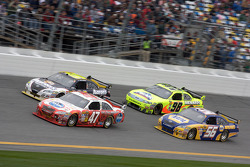 Marcos Ambrose, JTG Daugherty Racing Toyota, David Reutimann, Michael Waltrip Racing Toyota, Martin Truex Jr., Michael Waltrip Racing Toyota and Paul Menard, Richard Petty Motorsports Ford