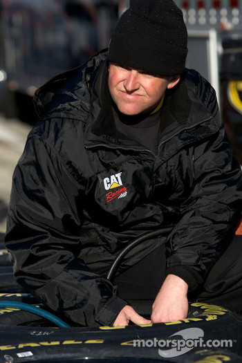 Richard Childress Racing Chevrolet team member prepares wheels