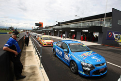 Cars line up in pit lane ready for the start of qualifying