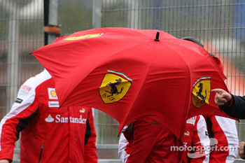 The wind gets up, blowing around a Ferrari umbrella