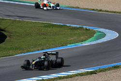Heikki Kovalainen, Lotus F1 Team leads Adrian Sutil, Force India F1 Team