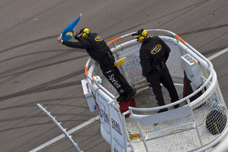 The NASCAR officials show the move over flag