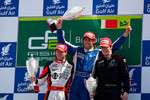 Giacomo Ricci celebrates his victory on the podium with Sam Bird and Alvaro Parente