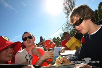 Sebastian Vettel, Red Bull Racing signs autographs
