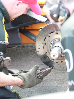 A team member works on a brake disc