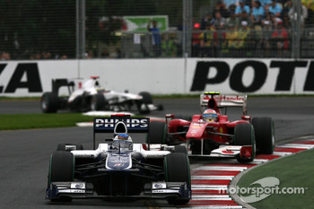 Rubens Barrichello, Williams F1 Team leads Fernando Alonso, Scuderia Ferrari