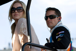 Casey Mears and his wife sit on top of the No. 11 pit box