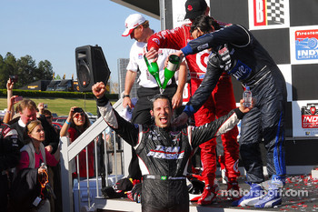 Scott Dixon and Dario Franchitti pour champagne on Helio Castroneves