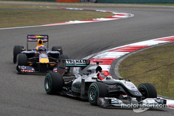 Michael Schumacher, Mercedes GP leads Mark Webber, Red Bull Racing