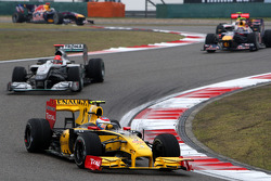 Vitaly Petrov, Renault F1 Team leads Michael Schumacher, Mercedes GP