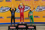 Scott Dixon on the podium with Dario Franchitti and Tony Kanaan