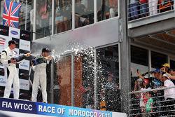 Race winner Philipp Eng sprays the champagne on the podium