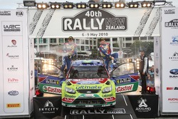Podium: winners Jari-Matti Latvala and Miikka Anttila celebrate