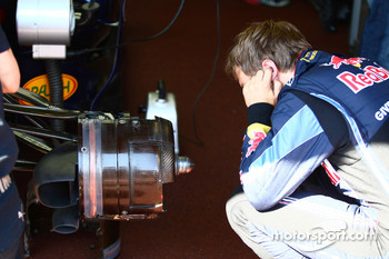 Sebastian Vettel, Red Bull Racing looking at his brakes