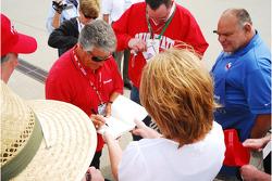 Mario Andretti signs autographs