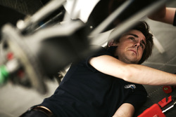 A mechanic works on the car of Vittorio Ghirelli