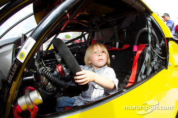 A young fan inside the #63 Corvette Racing Chevrolet Corvette C6 ZRL