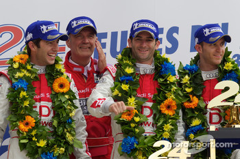 LMP1 podium: class and overall winners Mike Rockenfeller, Romain Dumas and Timo Bernhard celebrate with Dr. Wolfgang Ullrich