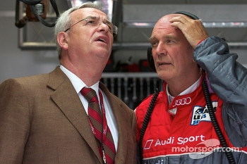 VAG Chaiman of the Board Martin Winterkorn and Dr. Wolfgang Ullrich watch the end of the race while the last Peugeot 908 on track retires