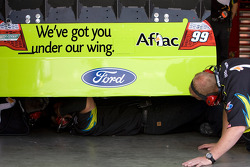 The No. 99 crew works on the car