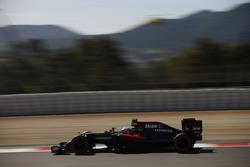 Jenson Button, McLaren MP4-31 on track