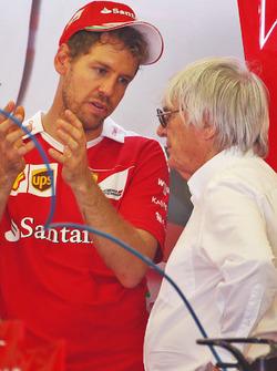 (L to R): Sebastian Vettel, Ferrari with Bernie Ecclestone