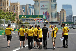 Kevin Magnussen, Renault Sport F1 Team and Esteban Ocon, Renault Sport F1 Team Test Driver walk the circuit with the team