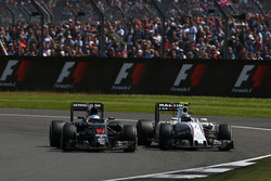 Fernando Alonso, McLaren Honda F1 Team MP4-31 and Valtteri Bottas, Williams Martini Racing FW38