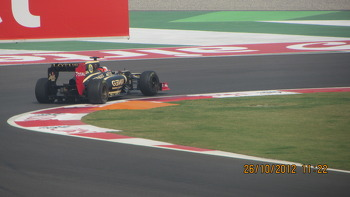 Raikkonen's E20 hitting the apex at Turn 1
