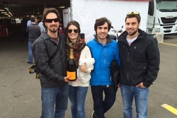 John Farano's son's and daughter in law share some of  John's Second place Champagne