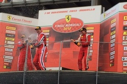 Jim Weiland joins in the champagne spraying after finishing 2nd in Friday's Coppa Shell Race
