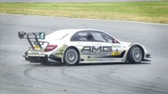 Nicky Hayden takes a DTM car for a 