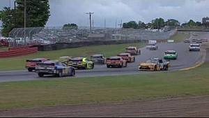 Several cars wreck on a restart in the rain